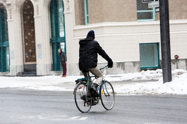 Cyclist crossing a road with fenders on his bike