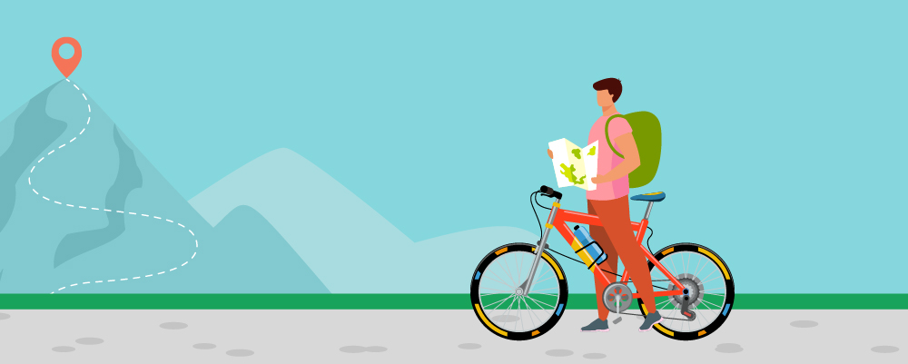 Man with a planned route for his bike touring